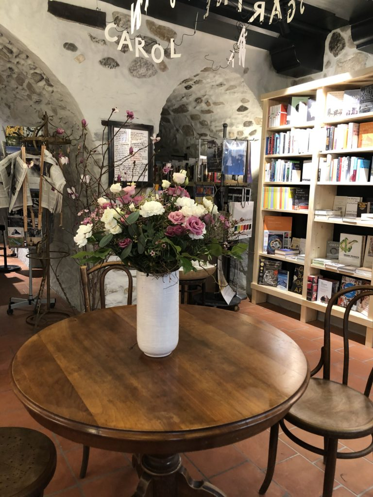 flowers on the table in the bookstore